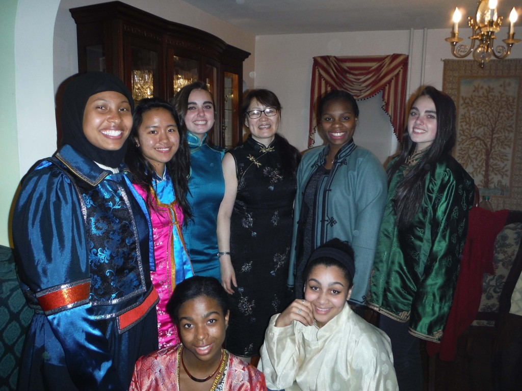 Munhtuya Goulden (in glasses) and the WINS girls celebrate Mongolian New Year in traditional garb. Photo: Betsy Payne