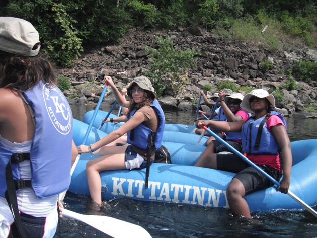 Young women rafting