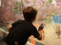 Boy Drawing on Diorama