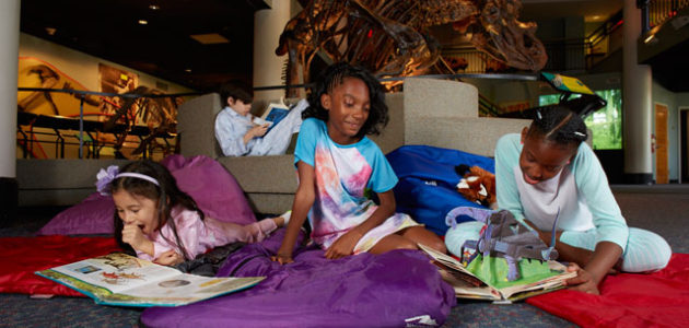 Girls enjoy indoor family fun at a dinosaur museum overnight