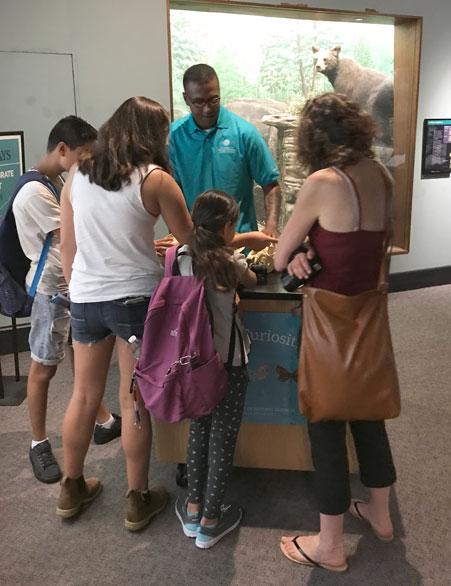 Volunteer with visitors