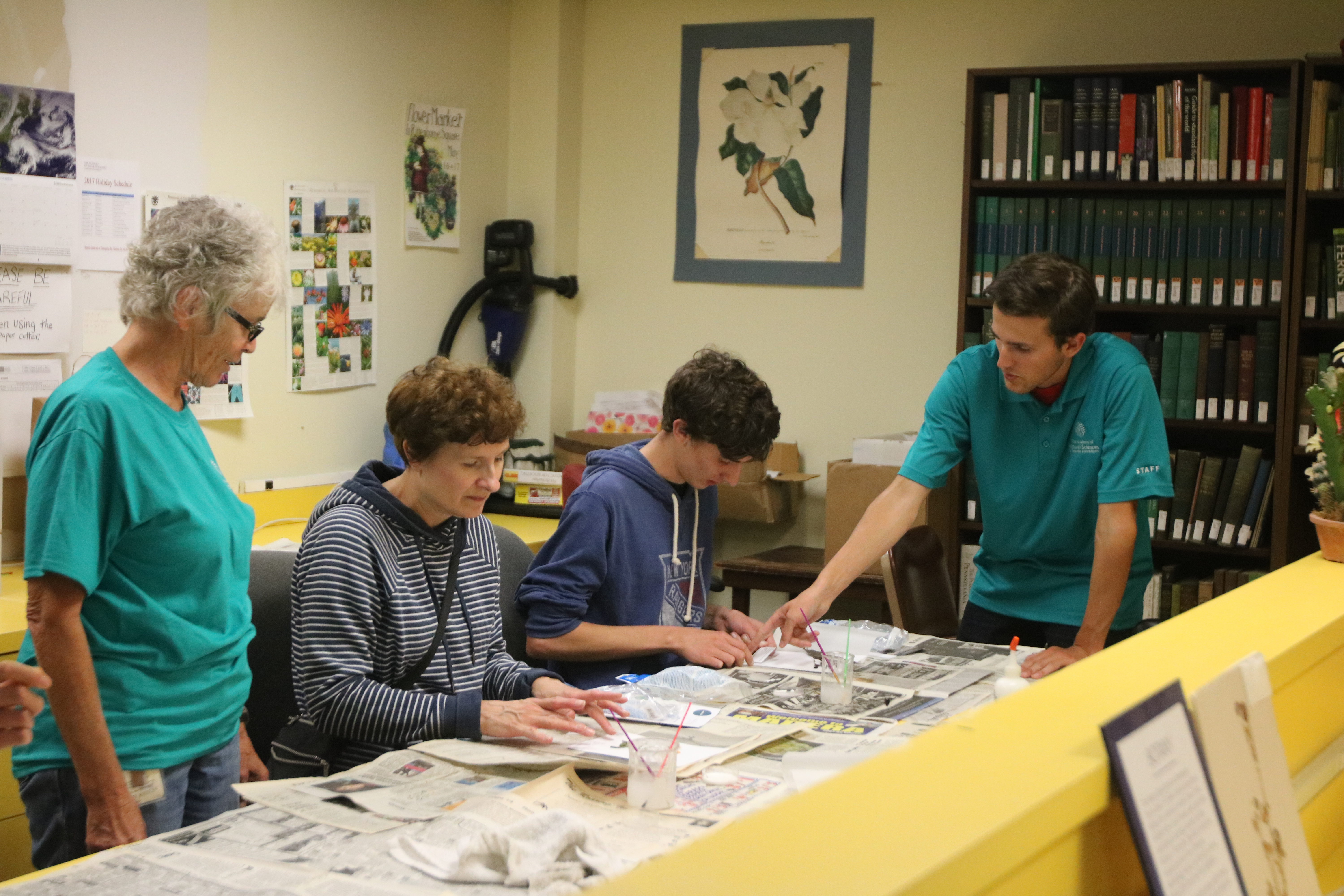 Members learn how to make their own herbarium