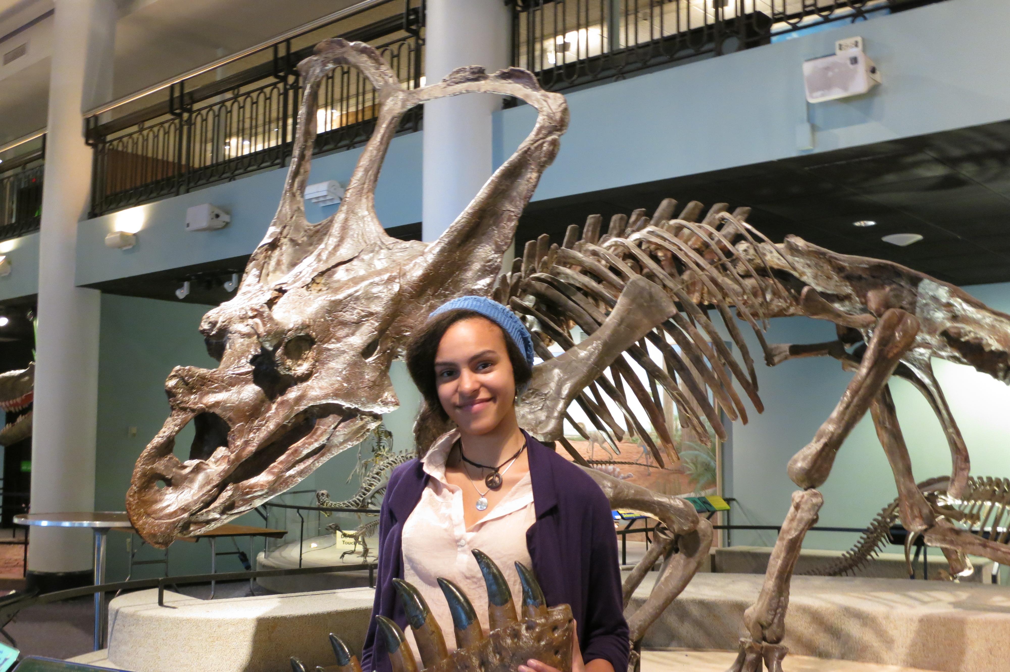 Women holding dinosaur jaw fossil