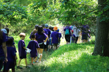 Academy Science Campers hike through the woods
