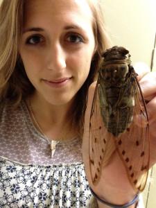 Isa Betancourt with a cicada.