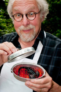 """""""The Bug Chef"""" with a cooked scorpion. Photo by  Jeff Cole."""