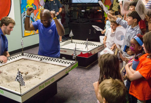 Playing Roach Race 500. Photo by Meredith Dolan/ANS.