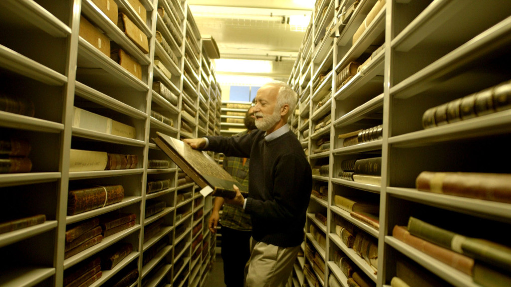 Senior Fellow Robert Peck  and Hitnes in the archives.