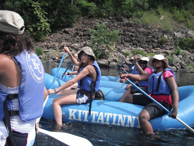 Young women rafting