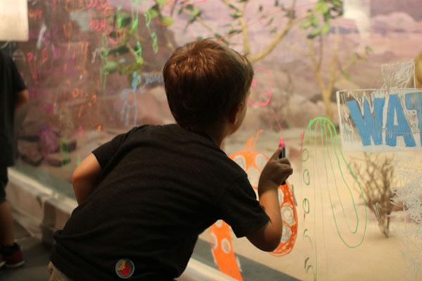 Boy Drawing on Diorama