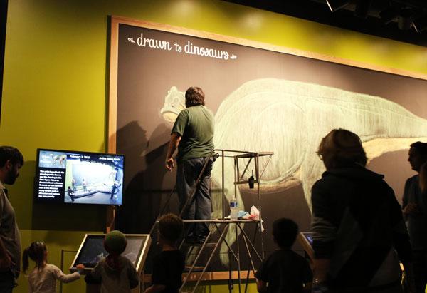 Man drawing dinosaur