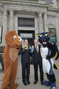 Announcing the affilation with Drexel University, Drexel President John Fry (left) and George Gephart flanked by friendly mascots.