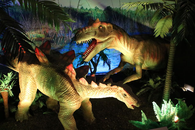 See roaring, moving dinosaurs on a flashlight tour during a family museum overnight at Philly's dinosaur museum