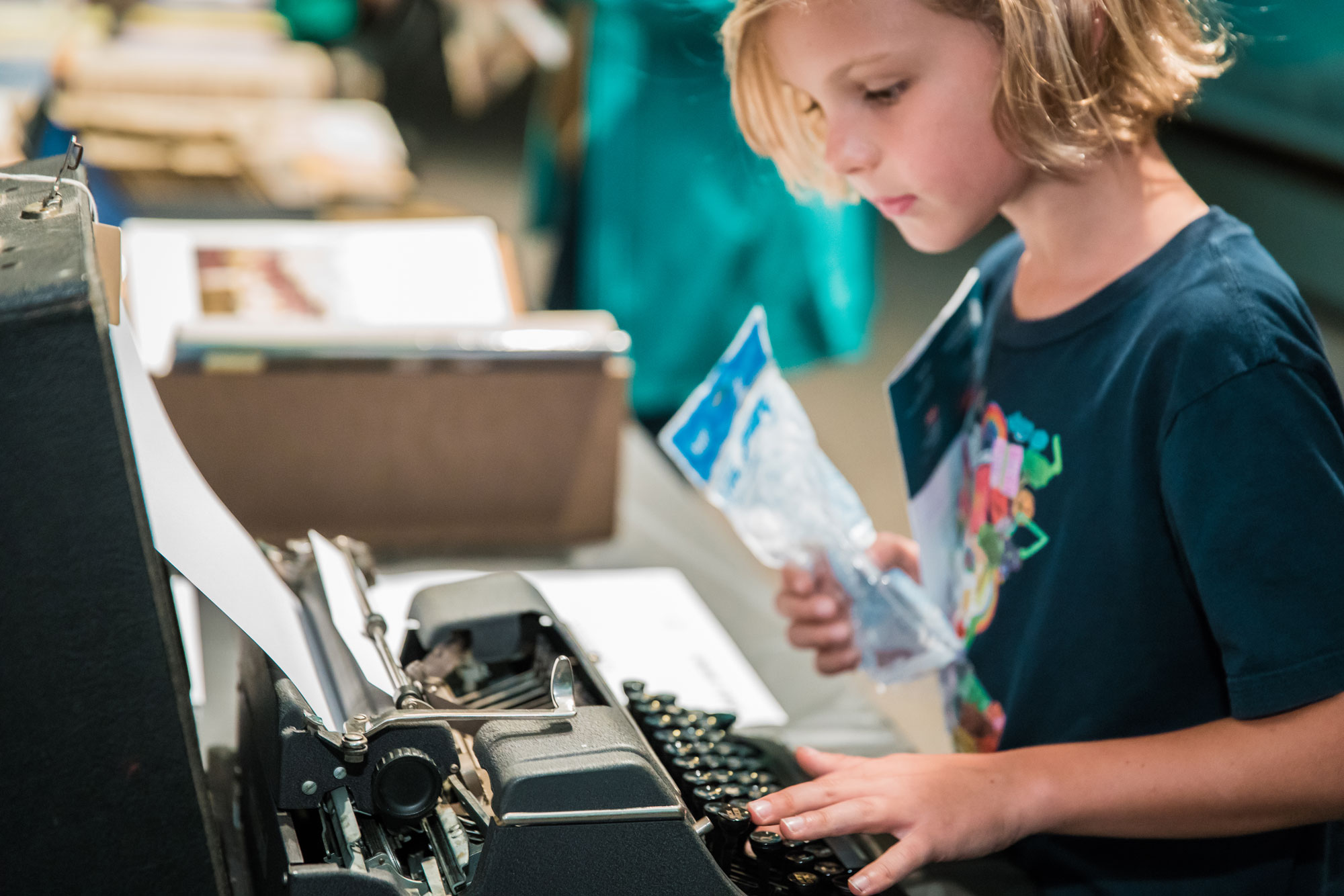 Child uses typewriter