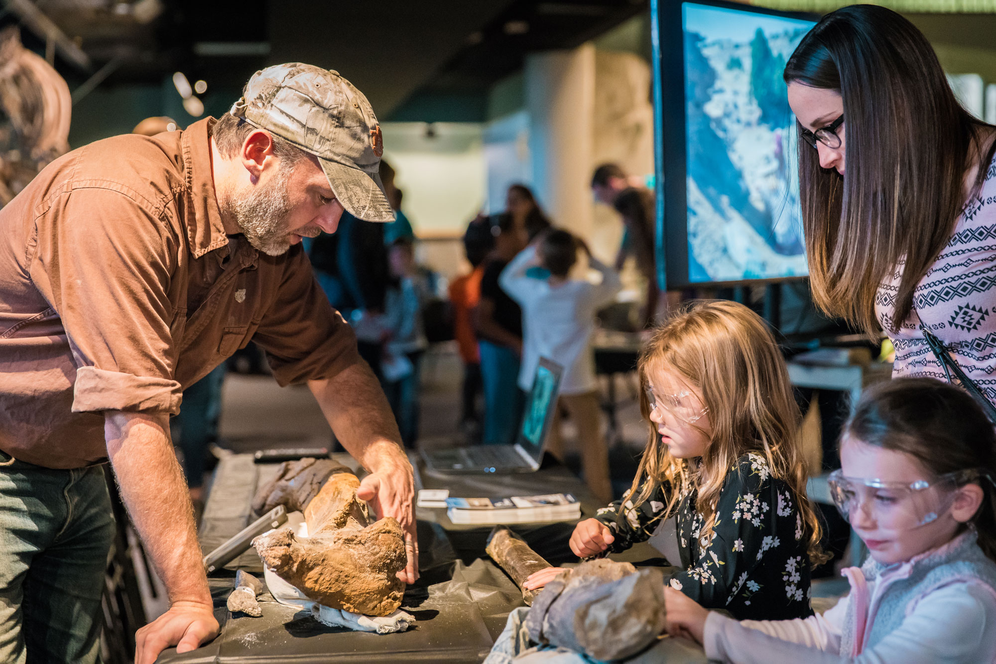 Children examine real fossils at Members' Night