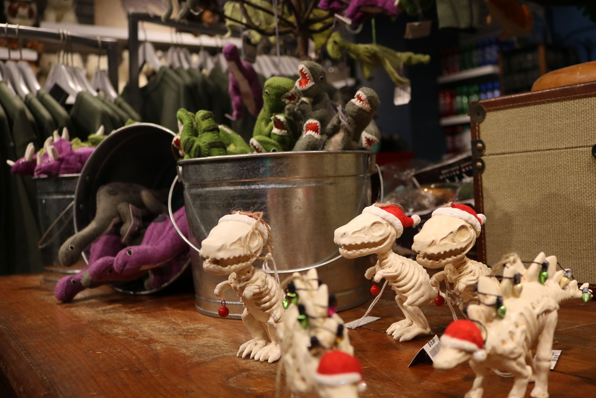Dinosaur Christmas tree ornaments, skeletons with Santa hat