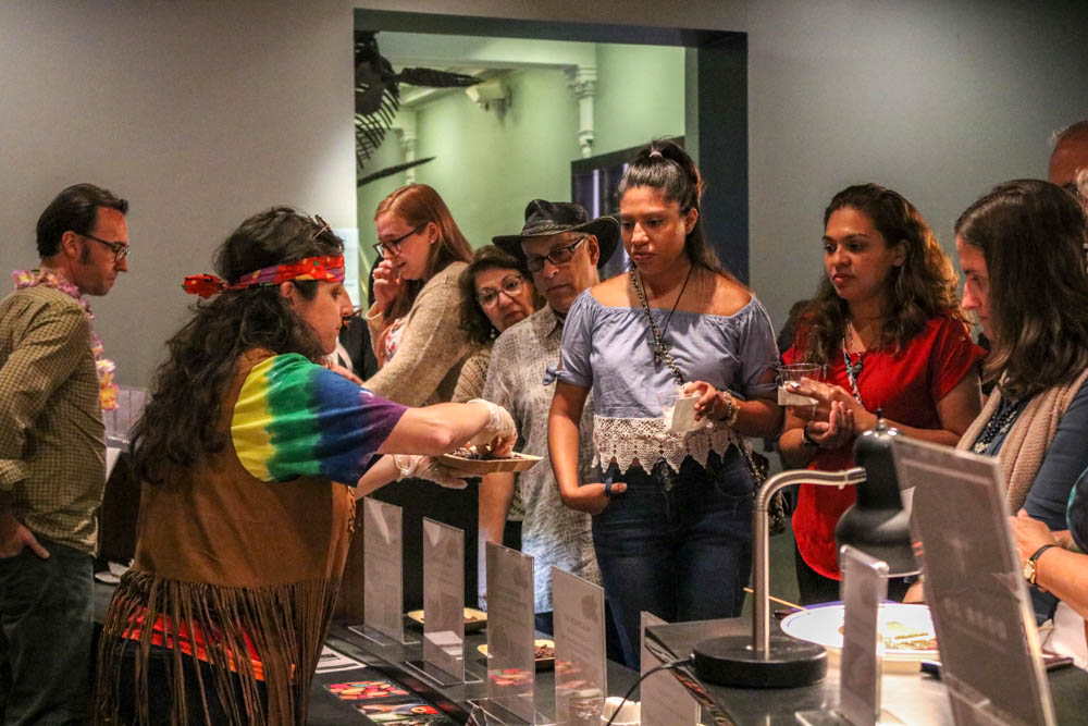 Woman serves chocolate to group of young women