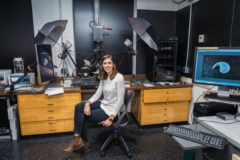 Female scientist in front of scanning equipment