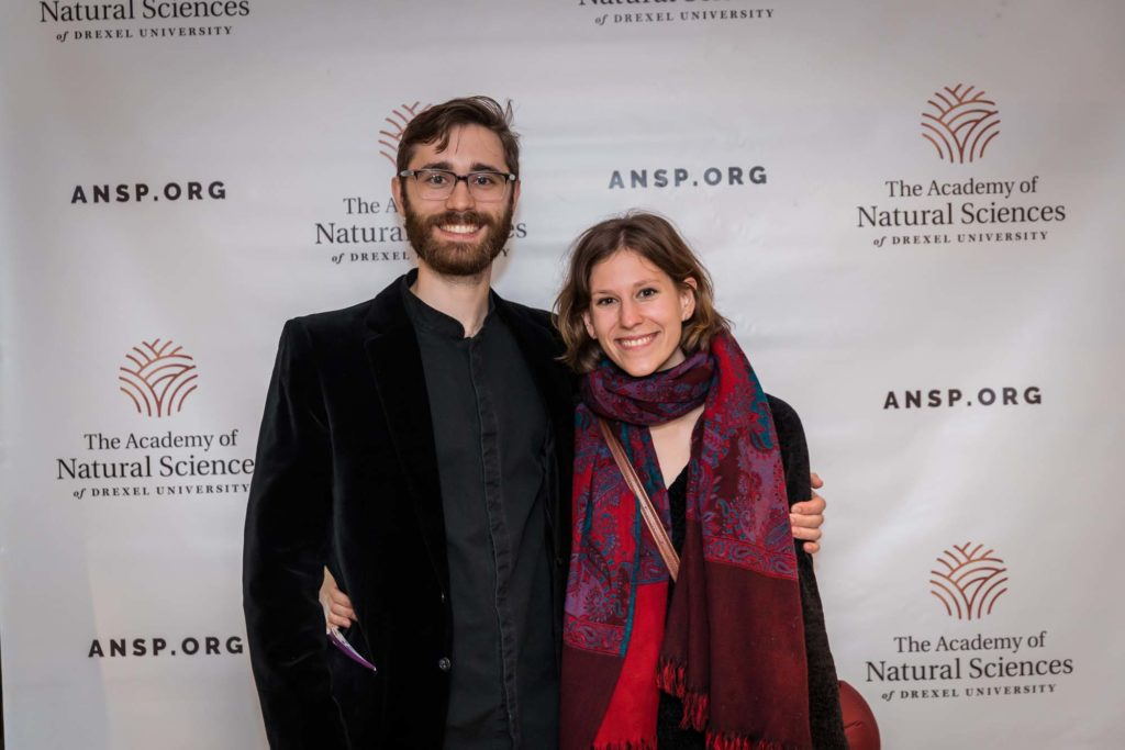 Young couple poses in front of ansp.org background