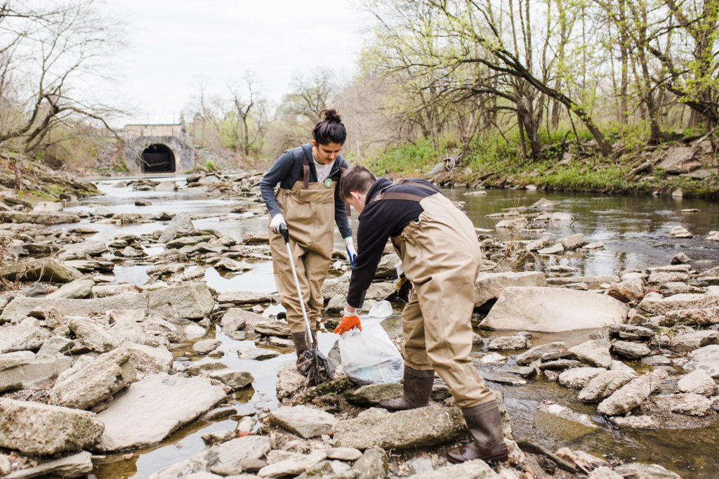 Young adults pick up trash at Frankford Creek