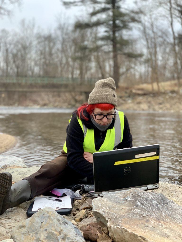 woman at stream w laptop