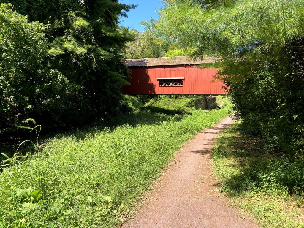 covered  bridge along a dirt path