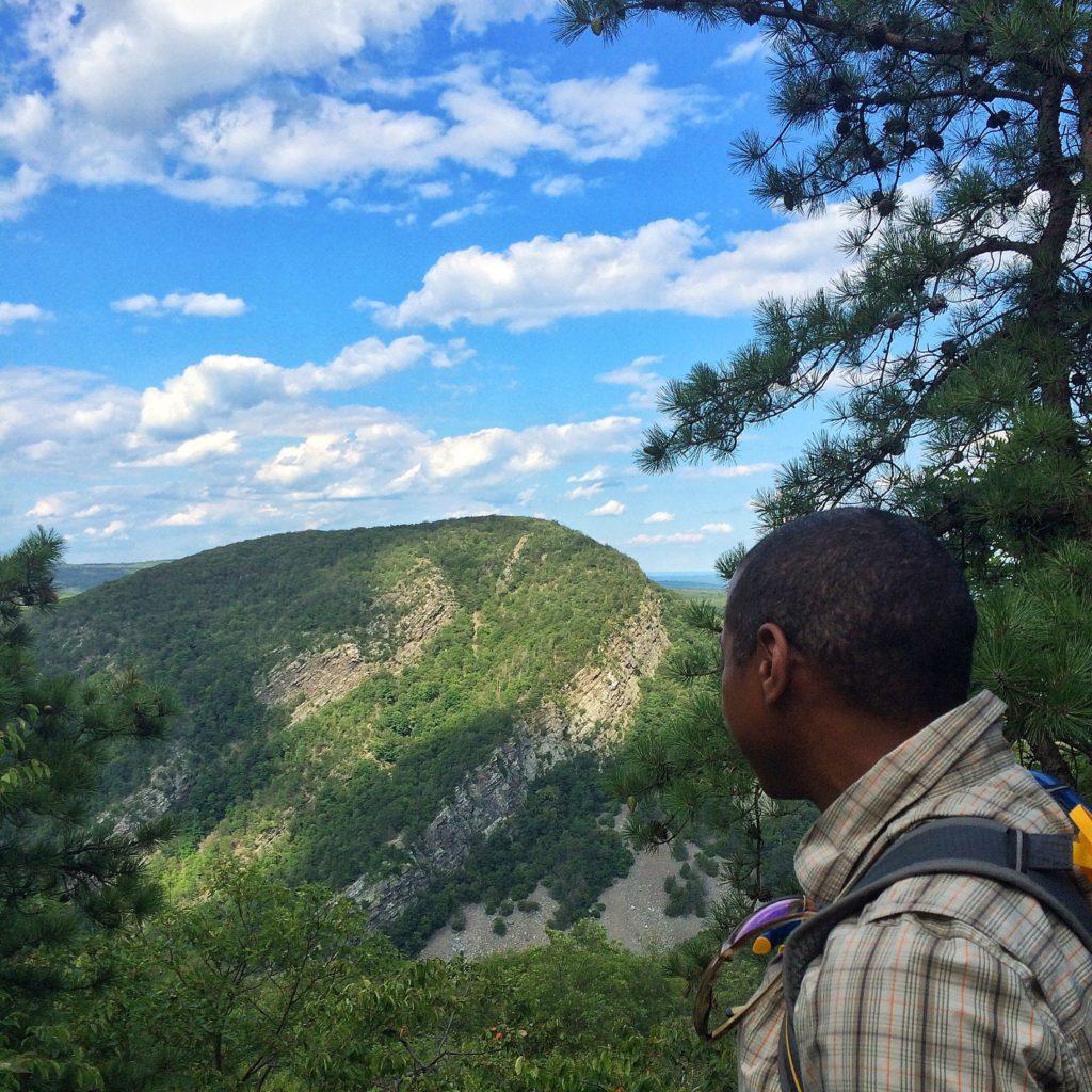 man looking out at mountain vista